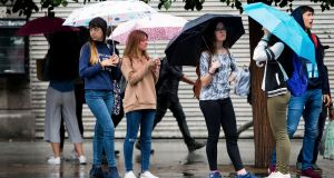 Rain is set to return on Thursday night and Friday. A small amount of rain fell last weekend. Here people shelter from it on Dublin's O'Connell Street. Photograph: Tom Honan