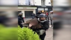 Macron security official recorded beating protesters