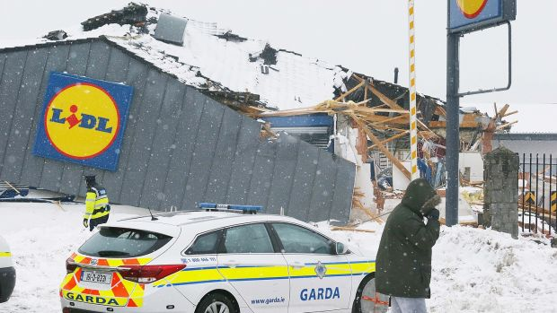 Image from March 2018 of gardaí at the scene following looting at a Lidl store in Jobstown, Co Dublin. File photograph: Stephen Collins