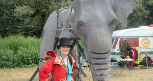Dea Birkett with a lifesize elephant puppet