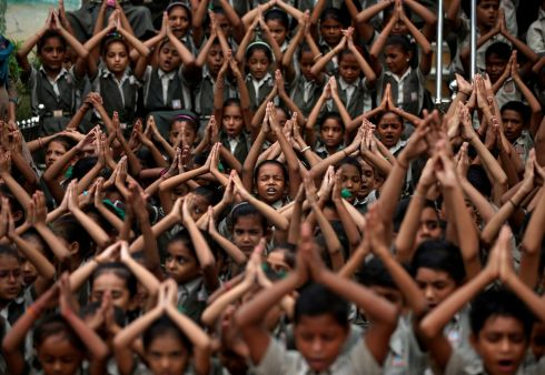 NOT A DROP: School students pray for rain at a temple in Ahmedabad, India. Photograph: Amit Dave/Reuters