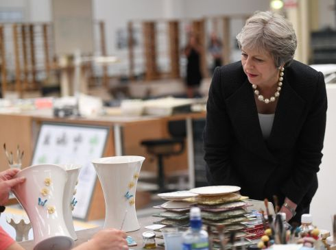 POTTERING ON: Britain's prime minister Theresa May visits Belleek Pottery, in St Belleek, Co Fermanagh. Photograph: Clodagh Kilcoyne/Reuters