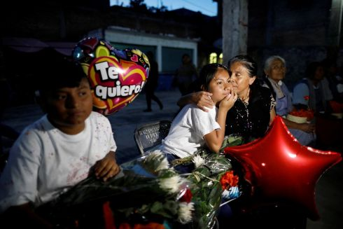 AN OVERDUE REUNION: US-born Mexican Joselyn Acteopan is embraced by her grandmother, after a Mexican NGO organised a reunion for 18 children to return to their homeland and meet their family members in Teopantlan, Puebla. Photograph: Carlos Jasso/Reuters
