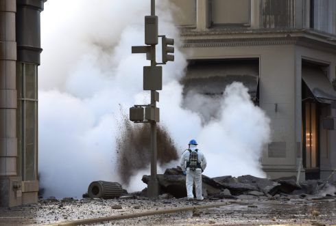 WHAT LIES BENEATH: A worker looks at steam coming from 5th Avenue after a steam explosion tore apart the street in the Flatiron District of New York. Photograph: Timothy A Clary/AFP/Getty Images