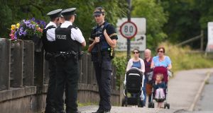PSNI officers chat with a  Garda on the Border   in  Belleek, Co Fermanagh, during Theresa May's visit to the area. Photograph: Clodagh Kilcoyne/Reuters