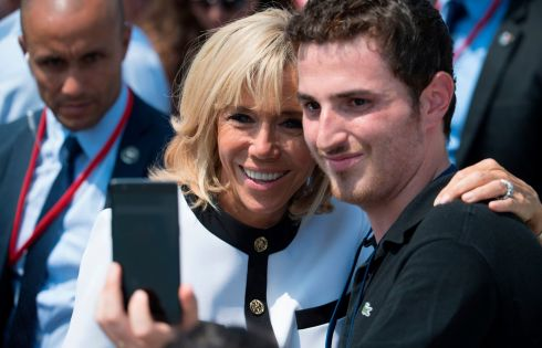 PRESIDENTIAL MARK II: wife of French president Brigitte Macron poses for a selfie after the annual Bastille Day military parade on the Champs-Elysees avenue in Paris last weekend. Photo: Eric Feferberg/Getty Images