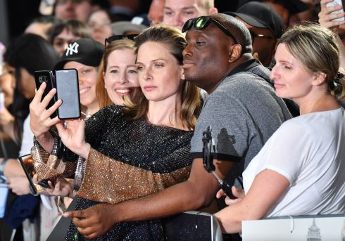 "ON THE RED CARPET: Actor Rebecca Ferguson takes a selfie with a fan as she attends the UK premiere of ""Mission: Impossible - Fallout""  in London last weekend. Photo: Jeff Spicer/Getty Images"