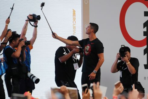 NEVER ONE TO BE OUTDONE: New Juventus soccer player Cristiano Ronaldo of Portugal takes a selfie with fans  during his visit to Beijing this week for his annual 'CR7 tour'.  Photo: EPA/Wu Hong