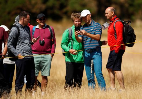 FAIRWAY FANS: Defending champion Jordan Spieth takes a selfie with a fan during a practice round of the British Open in Carnoustie. Phot: Reuters/Jason Cairnduff