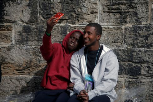 RELIEF EFFORT: A migrant, intercepted aboard a toy dinghy off the coast in the Strait of Gibraltar, takes a selfie after arriving on a rescue boat at the port of Tarifa, southern Spain. Photograph: Reuters/Jon Nazca