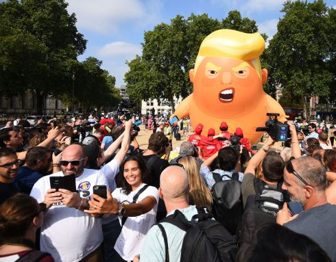 PROTEST: People take a 'selfie' as a 'Baby Trump' balloon rises after being inflated  in London's Parliament Square, as part of the protests against the visit of US president Donald Trump to the UK last week.  Photo: Kirsty O'Connor/PA
