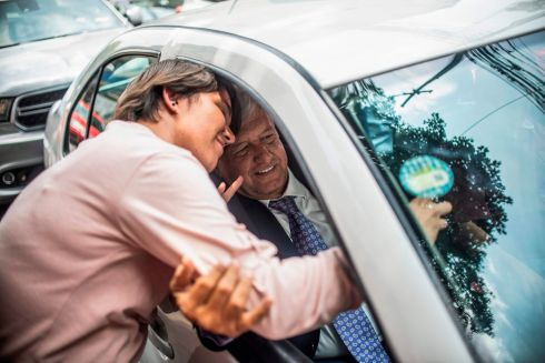 POLITICAL: A supporter of Mexico's president-elect Andres Manuel Lopez Obrador (AMLO) approaches  his car to get a selfie with him as he leaves the party's headquarters in Mexico City.  Photo: Getty Images
