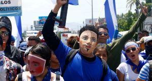 "Demonstrators in Managua wearing traditional masks take part in a march on July 12th called ""Together we are a volcano"" against Nicaraguan president Daniel Ortega's government. Photograph:  Oswaldo Rivas/Reuters"