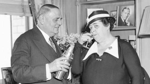 Oscar of the Waldorf: Oscar Tschirky, the hotel's maitre d' – here trying out a new cocktail on a guest in 1934 – is said to have refined eggs Benedict before adding the dish to the Waldorf menu. Photograph: Bettmann/Getty