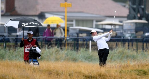 3d83b157af8003 Rory McIlroy plays from the rough during the second round of the British  Open at Carnoustie