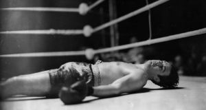 Doyle on the ring floor after being knocked down in the first round of his fight against Eddie Phillips at White City, London in 1939. Photograph: Topical Press Agency/Getty Images