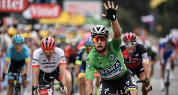Slovakia s Peter Sagan celebrates as he crosses the finish line to win the  13th stage of fda9ff094