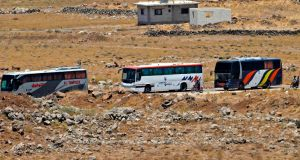 Buses  transferring Syrian rebel fighters and civilians to opposition territory in Idlib.  Photograph: AFP Photo