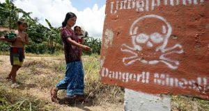 A sign warning of landmines in a former Khmer Rouge stronghold near the Thai border. Photograph: Tang Chhin Sothy/AFP/Getty Images
