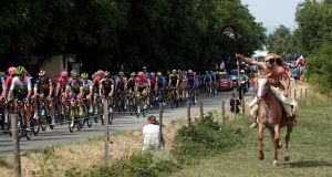 The peloton in full flight on the 169.5km stage 13 from Bourg d'Oisans to Valence. Photograph: Benoit Tessier/Reuters