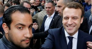 Alexandre Benalla protecting Emmanuel Macron in Rodez, on  May 5th, 2017. Photograph: Regis Duvignau