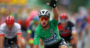 Slovakia's Peter Sagan, wearing the best sprinter's green jersey, celebrates as he crosses the finish line to win the 13th stage of the Tour de France. Photograph: Peter Dejong/AP