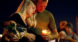 Brandon Webb and Carlye Michel participate in a candlelight vigil in the parking lot of Ride the Ducks on Friday. Photograph: AP