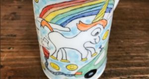 A mug by Tom Edwards depicting a farting unicorn.  Photograph: Elon Musk/Twitter