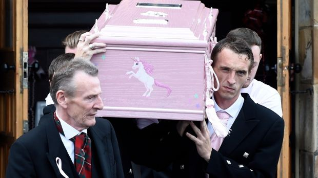 The coffin of six-year-old Alesha MacPhail is carried out of the Coats Funeral Home in Coatbridge, Scotland. Photograph: Lesley Martin – WPA Pool/Getty Images