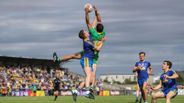 Odhrán Mac Niallais of Donegal gets above Niall McInerney of Roscommon to claim the ball during the All-Ireland SFC quarter-final Super 8s game at Dr Hyde Park. Photograph: Tommy Dickson/Inpho