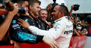 Lewis Hamilton celebrates winning the German Grand Prix  with his Mercedes team members. Photograph:  Ralph Orlowski/Reuters