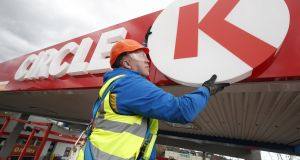An engineer works on a newly rebranded Circle K service station in Rathfarnham, Dublin, in April. Circle K is set to operate three new motorway service areas. Photograph: Conor McCabe