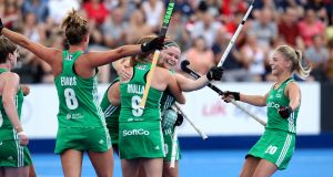 The Irish team celebrate after Shirley McCay scores  during the  World Cup match against the USA at the Lee Valley Hockey Centre in London. Photograph: Sean Dempsey/EPA