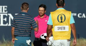 USA's Jordan Spieth (left) and USA's Xander Schauffele shake hands at the end of their rounds on the 18th during day four of the Open Championship 2018 at Carnoustie. Photograph: Jane Barlow/PA Wire