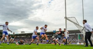 The ball goes past Monaghan goalkeeper Rory Beggan, scored by David Clifford of Kerry (out of picture) for Kerry's late goal at St Tiernach's Park in Clones. Photograph: Brendan Moran/Sportsfile via Getty Images