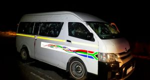 A minibus with bullet holes on its side  on the road in KwaZulu Natal province, South Africa on Sunday morning. Photograph: Claudine Senegal/Ladysmith Herald via AP)