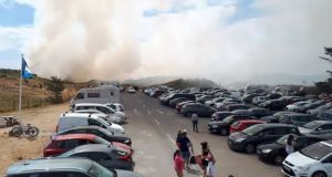 Hundreds of people were evacuated from Curracloe beach in Co Wexford on Sunday after a fire broke out in the sand dunes. Photograph: Surf Shack Curracloe/Facebook