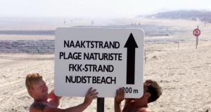 A sign for the proposed new naturist beach is put up in Bredene, Belgium. Photograph: Peter Maenhoudt/AP