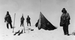 Members of Capt Robert Scott's party discover the tent of Norwegian explorer Roald Amundsen at the South Pole in January 1912. Photograph: Central Press/Getty Images