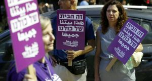 Demonstrators attend a rally to protest against the Jewish nation state Bill in Tel Aviv. Photograph: Jack Guez/AFP/Getty Images