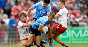 Jonny Cooper claims possession despite the efforts of Tyrone's Mark Bradley and Niall Sludden at Healy Park. Cooper was immense at the heart of Dublin's defence. Photograph: James Crombie/Inpho