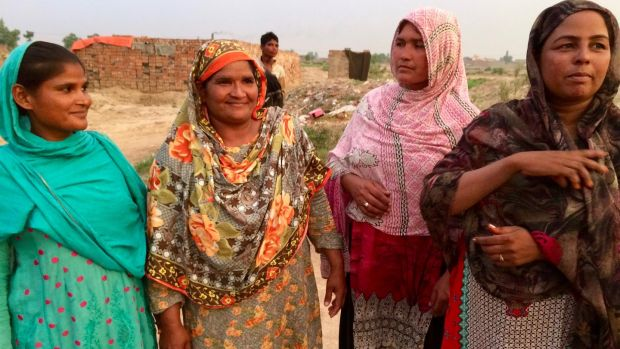 Sangita, Shamin, Nusrat and Maqsudan at a brick kiln in the village of Mian Rashid outside Lahore. Photograph: Lorraine Mallinder
