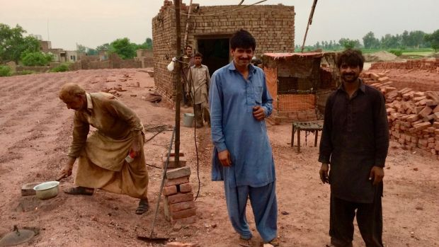 Brick kiln workers in the village of Mian Rashid, near Lahore. Photograph: Lorraine Mallinder