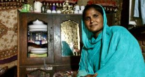 Sangita Muqsood in her room in the brick kiln where she works, near Lahore. Photograph: Lorraine Mallinder