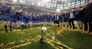 The Leinster players celebrate with the Pro14 and Champions Cup trophies after their win over the Scarlets last season. Photograph: Billy Stickland/Inpho
