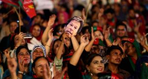Supporters of Imran Khan listen to him speak at an election campaign rally in Karachi on Sunday. Photograph: Shahzaib Akber/EPA