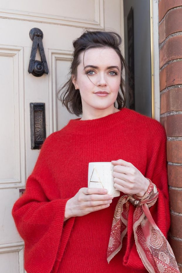An H & M jumper with bell sleeves bought in a charity shop in Capel Street. The scarf belonged to her grandmother. Pic Pearl Phelan
