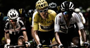 Geraint Thomas, wearing the overall leader's yellow jersey, rides during the 16th stage. Photograph: Getty Images
