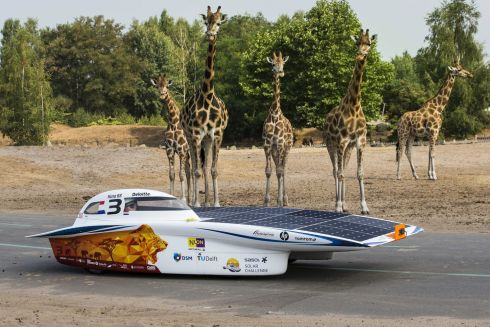 "OUTSIZED HOOD: A ""sun car"" powered by solar energy is presented by the Nuon Solar Team at Safari Park Beekse Bergen in Hilvarenbeek, Netherlands. The car will be used during the Sasol Solar Challenge, in which teams drive across South Africa in an eight-day event starting in September. Photograph: Vincent Jannink/EPA"