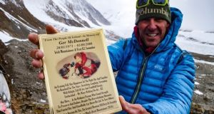 K2 summiteer Jason Black from Letterkenny, Co Donegal, with a plaque he took to the K2 base camp in memory of the first Irishman on the K2 summit: Ger McDonnell of Kilcornan, Co Limerick.